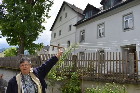 Oma pointing to her room at the school