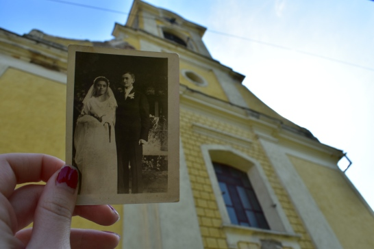 A picture of my great-grandparents on their wedding day in front of the church they got married in.