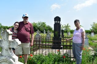 My family stands by the same grave.