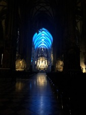 The lit-up inside of St. Stephen's Cathedral at night. Organ music was also playing.