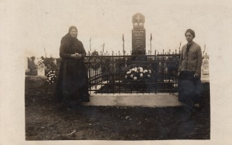 My great-great grandmother and great aunt stand by my great-great grandfather's grave and my great-great grandmother's future grave.